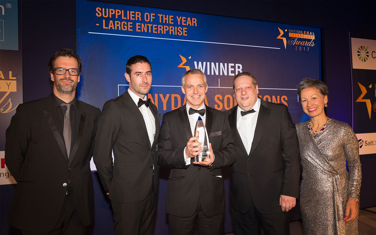 Photo of the AnyData team winning Supplier of the Year at the 2017 British Technology Awards